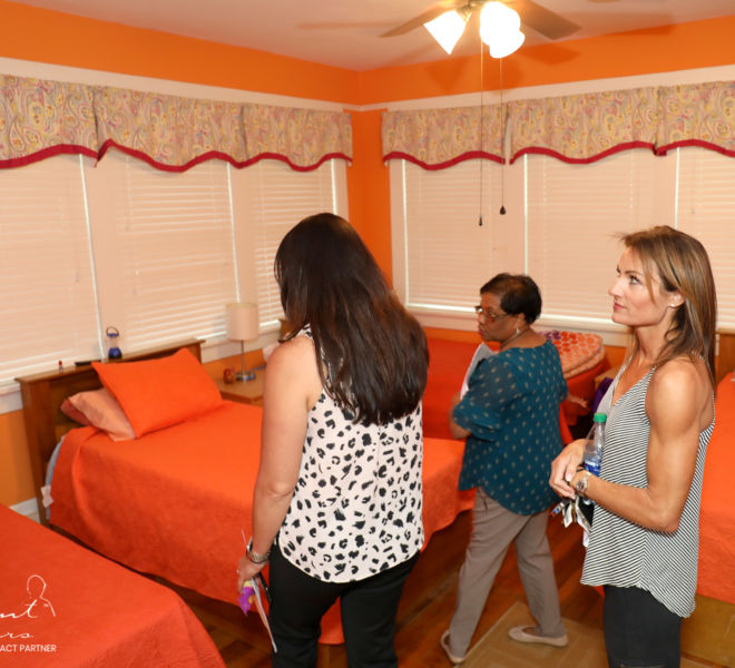 Silent Tears staff looking inside YWCA bedrooms